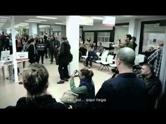 """Flashmob oficina paro (Carne Cruda 2.0). A program on Spanish radio, organized a small flashmob to perform and sing The Beatles' """"Here Comes the Sun"""" for one of the unemployment offices in Madrid."""