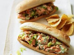 Lobster roll style salmon sandwich - this clever take on the summertime classic, salmon replaces lobster and yogurt stands in for mayonnaise. Topping rolls with potato chips adds crunch and fun. Mega Sandwich, Salmon Sandwich, Salmon Salad, Fish Recipes, Seafood Recipes, Great Recipes, Cooking Recipes, Summer Recipes, Recipe Ideas