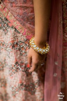 Bridal Details - Gold Cutwork Kundan Bangle, Pink Lehenga with Stone Work | WedMeGood  #wedmegood #indianbride #indianwedding #bangle #kundan #bridaldetails