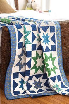 """Double Stars quilt project A combination of blue and green prints coupled with a white solid provides a crisp, cool summer quilt project. The blocks in this design feature a small six-point star surrounded by a larger star. Check out Double Stars in Love of Quilting July/Aug '14. size: 68"""" x 80"""" rating: intermediate"""