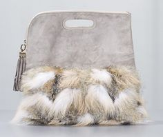 Authentic Derek Lam Fur Clutch Bag. Done in taupe suede and fur kashimira with gold metal hardware. This is a fold over style clutch with cutout handle and exterior zipper pocket. The top zipper closure includes a hanging taupe suede tassel.  - goalsBox™