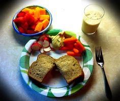 Lunch Sandwich - 12 grain bread with fresh sliced tomatoes, onions, basil, 1/2 tsp of balsamic vinnegrette, sea salt & course ground black pepper Sliced radishes & baby carrot w/ Garlic humus dip 6oz Vanilla Silk Small bowl of diced Watermelon & Cantaloupe