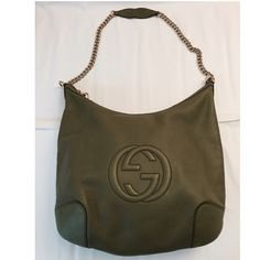 """GUCCI Pebbled Calfskin Medium Soho Chain Shoulder This is an Authentic GUCCI Pebbled Calfskin Medium Soho Chain Shoulder Bag in green. Condition: Preloved in EXCELLENT condition Exterior: water stain on back bottom left Interior: - very good but has only one small stain shown in the pic Handle: good Hardware: firm zipper, small scratches. Please see pictures for more detail and condition. Measurement approx:                                             L 17"""" x W 3"""" x H 15"""" Drop: 17"""". Gucci…"""