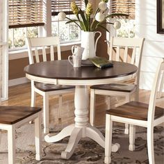 Bring a touch of vintage style to your home with the Whitesburg Round Dining Room Table Base and Top. Designed with a fashionable two-tone finish, this round table will be a centerpiece in your dining room for years to come.