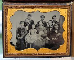 (c. 1859) A family and their young African American slave nanny.