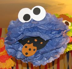 "Blue Monster tissue paper pompom,  ""Cookie Monster"" from Sesame Street."