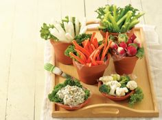 Check out this fresh appetizer made ready in just 30 minutes! Salad greens, jicama, carrots, celery, radish, cauliflower and broccoli served with spinach dip – a colorful vegetable platter!