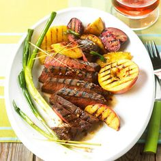 Fruit-and-Fire Flat Iron Steaks - A trio of grilled pineapple slices, plums, and nectarines make a meal out of this Asian-flavored steak main dish recipe.