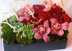 Hidden Garden red rose cymbidium orchid and succulent centerpiece