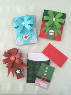 """I love these!  DIY Christmas gift card holders from the Holiday Nifty Gifties kit.  EVERYTHING is pre-cut, pre-measured, and everything you need to make these is right in the kit!  The post has more photos of what's in this cool kit!  Kit can be purchased at www.heritagemakers.com/jenniferwise by clicking """"products"""" then """"Anthology"""" then """"Holiday Nifty Gifties.""""  #paper #papercrafting"""
