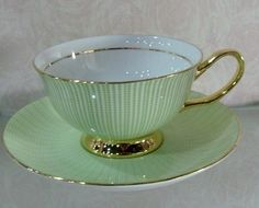 Green and gold tea cup and saucer. I Love this color ~