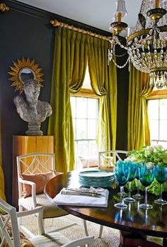 Love the curtains. source: R Higgins Interiors Green & blue dining room with dark teal walls paint color, green silk pinch-pleat window panels curtains, gold sunburst mirror, crystal chandelier, round dining table and white lattice chairs. Teal Walls, Dark Walls, White Walls, Decoration Inspiration, Interior Inspiration, Interior Ideas, Color Inspiration, My Living Room, Living Spaces