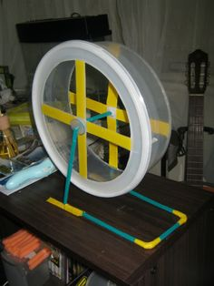 Plastic Container Exercise Wheel - PetDIYs.com