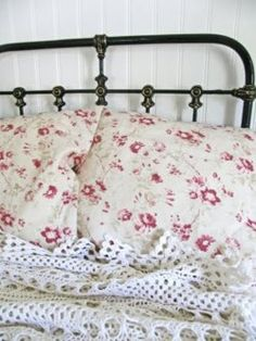 antique iron bed and floral linens