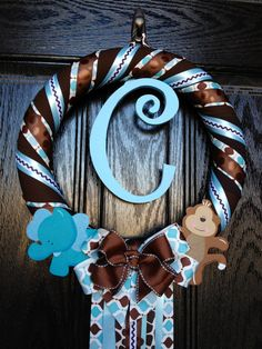 Brown and Blue Safari Baby Wreath by TopHatsAndTuTus on Etsy Baby Door Wreaths, Hospital Door Wreaths, Baby Boy Wreath, Hospital Door Hangers, Baby Door Hangers, Welcome Baby, Diy Wreath, Wreath Ideas, Baby Boy Newborn