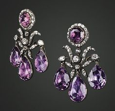 Rare Russian Jewels from a Personal Collection.. Of girandole design, each set with three pear-shaped amethyst drops to the diamond foliate motif and octagonal amethyst and diamond cluster surmount, mounted in silver and gold, circa 1765, 5.4cm long, in a fitted red leather case.  Estimate: Sfrs 100,000-150,000 (US$80,000-120,000) #GeorgianEarrings #AmethystGirandole #RococoJewelry