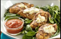 Grilled Chicken with Spinach, Feta and Red Pepper Sauce by Deborah Krashner, spryliving: The sweet pepper sauce picks up some smoke from the grill, a perfect counterpoint for the full-bodied sheep cheese dressing the herb-grilled chicken. #Chicken #Healthy #Mediterranean