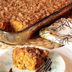 Pumpkin Coffee Cake w/ Brown Sugar Glaze Recipe Breads, Desserts with water, pumpkin purée, eggs, vanilla extract, pumpkin pie spice, yellow cake mix, baking soda, brown sugar, flour, butter, granulated sugar, vanilla extract, heavy whipping cream