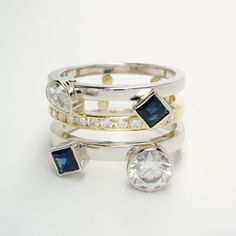A platinum & 18ct. yellow gold triple band ring with 2 square cut sapphires, round brilliant cut and pear diamonds rub-over set & 11 round brilliant cut diamonds channel set in the yellow. This is a remodel. Pear Diamond, Dress Rings, Cocktail Rings, Gold Bands, Band Rings, Sapphire, Channel, Diamonds, Wedding Rings
