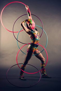 Rainbow Sprite, otherwise known as Amanda Syryda, lets her inner rainbow shine during a hula hoop photoshoot with Barefoot Photos in Canada.
