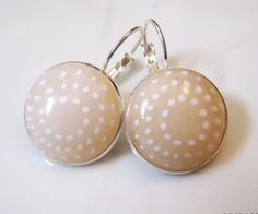 Millefiore cane with translucent over cream colored polymer clay earrings by Tova Reshef. Light Earrings, via Flickr.