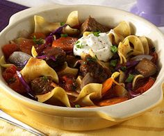 A teaspoon of cocoa contributes  flavor to this Old World Hungarian goulash recipe of sirloin steak with noodles in a beef broth mixture with cabbage, carrots, and onions. Serve the goulash with a dollop of sour cream.