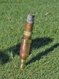 FREE SHIPPING until April 1st.  Copper Cigar Holder with brass or aluminum that can be dropped into the ground to hold cigar off of grass on Etsy, $25.00
