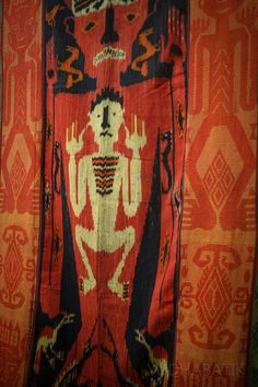 """Ikat Sumba """"hinggi"""" in """"tau"""" pattern. Named after the use of most important pattern, which is human or 'tau' ornaments in a woman figure ('rambu', a citation for Sumbanese women) which is mark depicted without a man's genital organ. This fabric is quite rare, because it's decorated not only with ikat, but also supplementary warp panel in both left and right side of the ikat section, which also woven in tau (a human figure) ornaments. Probably made in Kanatang, East Sumba - NTT"""