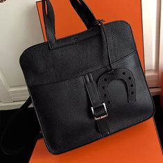 7ae825aabd62 Authentic Handbags Online Halzan 31 Bag in Black Taurillon Clemence Leather  - - Tirrup-shaped handles- Silver and palladium plated hardware- Adjustable  and ...
