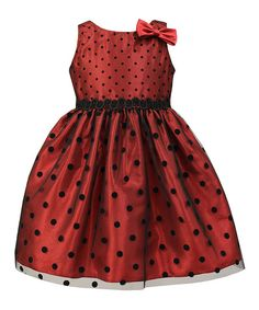 Dress up your little one in this party-ready dress boasting sweet polka dots and a tiny bow accent.