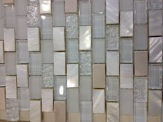 Tumbled travertine, mother of pearl, and glass tile. Looks better in person. Maybe for backsplash in kitchen