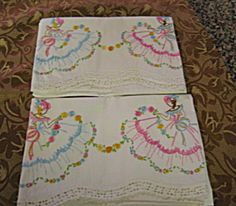 For sale online at More Than McCoy on TIAS; pretty vintage pillow cases with embroidered ladies at http://www.morethanmccoy.com