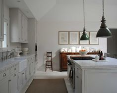 Loi Thai grey kitchen, industrial lights from GE factory
