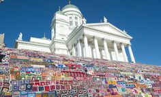Gigantic granny square quilt on the stairs of the Helsinki Cathedral