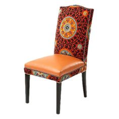 Bring exotic allure to your home dcor with this eye-catching design, artfully crafted for lasting appeal.     Product: Side chair  Construction Material: Leather and cotton  Color: Rust and multi    Dimensions: 20   H x 19   W x 21   D     Cleaning and Care: Professionally clean