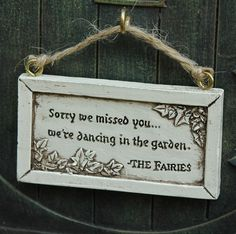 "This Fairy Door has English Tudor styling and a reversible sign.  Made of painted resin, it measures 5 x 7""."