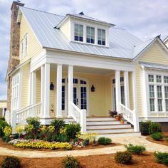yellow house exterior, from The Lettered Cottage Facebook page                                                                                                                                                                                 More