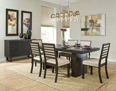 Wall art adds color and visual interest to this adorable contemporary dining room.