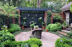 Patio with black wooden lattice and brick fence. Staircase with wooden pergola.