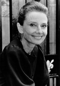 *-*heureux -    The UNICEF Goodwill Ambassador Audrey Hepburn photographed by Mauro Carraro in London (England), during a shoot specially for a campaign for UNICEF, on May 07, 1989.      Audrey was wearing:          Dress: Givenchy (of silk linen in navy blue with buttons of resin in the same color, short sleeves, of his haute couture collection for the Spring/Summer of 1989).  filed as: my love.  Audrey Hepburn.