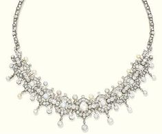 The front Composed of nine graduated old-cut diamond openwork panels with natural pearl centers and fringe detail interspersed with pearl and diamond collar bars to the openwork backchain, mounted in silver and gold, pearls untested, circa 1890,