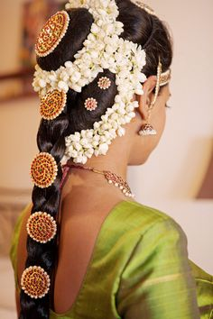 South Indian bridal wedding hair. Braid adorned with hair accessories. #TempleJewellery #jhumkis