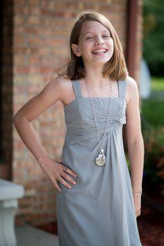 Gorgeous junior bridesmaid. Grey dress