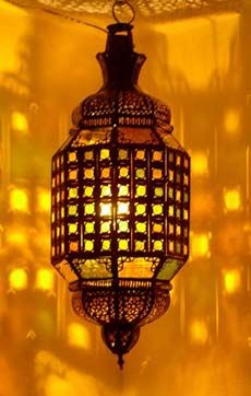 A unique lantern that comes with green, blue, amber, white and red stain glass. This lantern has alot of details, great workmanship, all handmade in Morocco. This beautiful lantern measures 28
