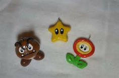 Polymer clay Goomba, Star and the flower charm