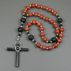 Girl rosary bracelet light reflection prayer beads handmade rosary anglican rosary in red jasper and black onyx with a cross of black stone and sterling negle Choice Image