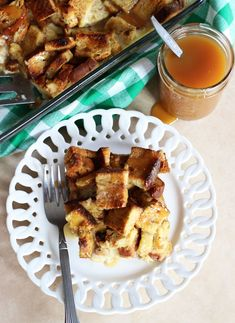 EGGNOG BREAD PUDDING WITH BUTTERSCOTCH SAUCE. Super easy bread pudding made with cinnamon-swirl bread, eggnog, vanilla, and butterscotch sauce! #thegoldlininggirl