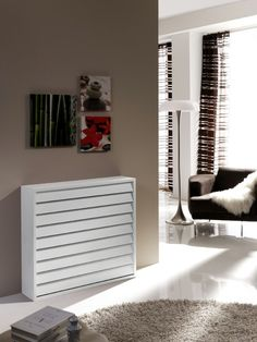 Radiator fairing living room white wooden planks of minimalist design of round shaggy rug beige