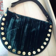 MAXX UNIQUE BAG Its deep green velvet material with royal looking golden embellishments. Strap is adjustable,  can be crossbody or shoulder. Strap is black leather. Quality of the bag is unexplainable.  Simply gorgeous. There are 2 zipped pockets inside . I have the matching dress also if someone interested. maxx new york  Bags Shoulder Bags