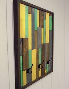 Reclaimed wooden coatrack...doubles as art.